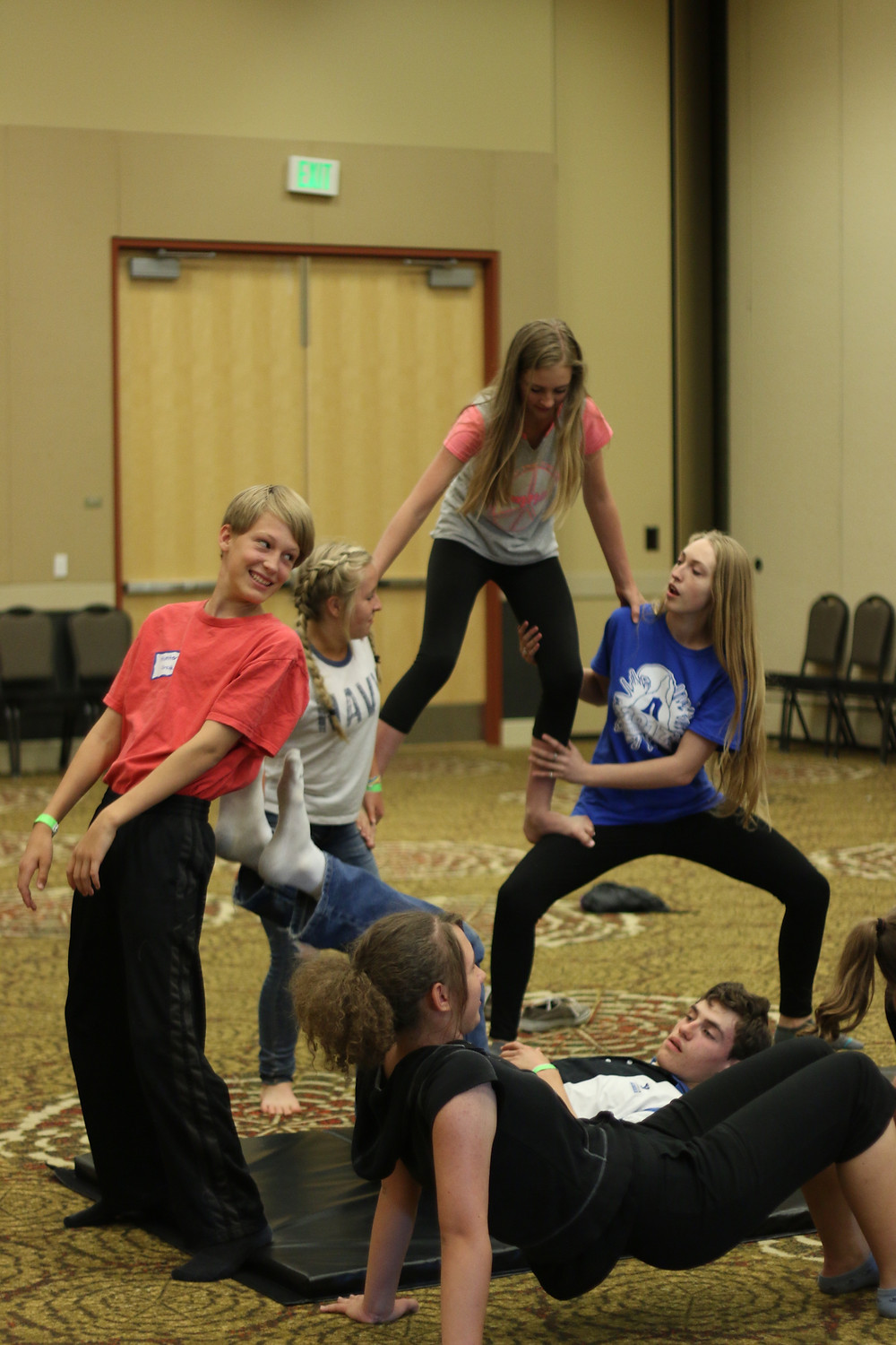 Students learning acro/pyramids at the UHEA 2017 Convention.