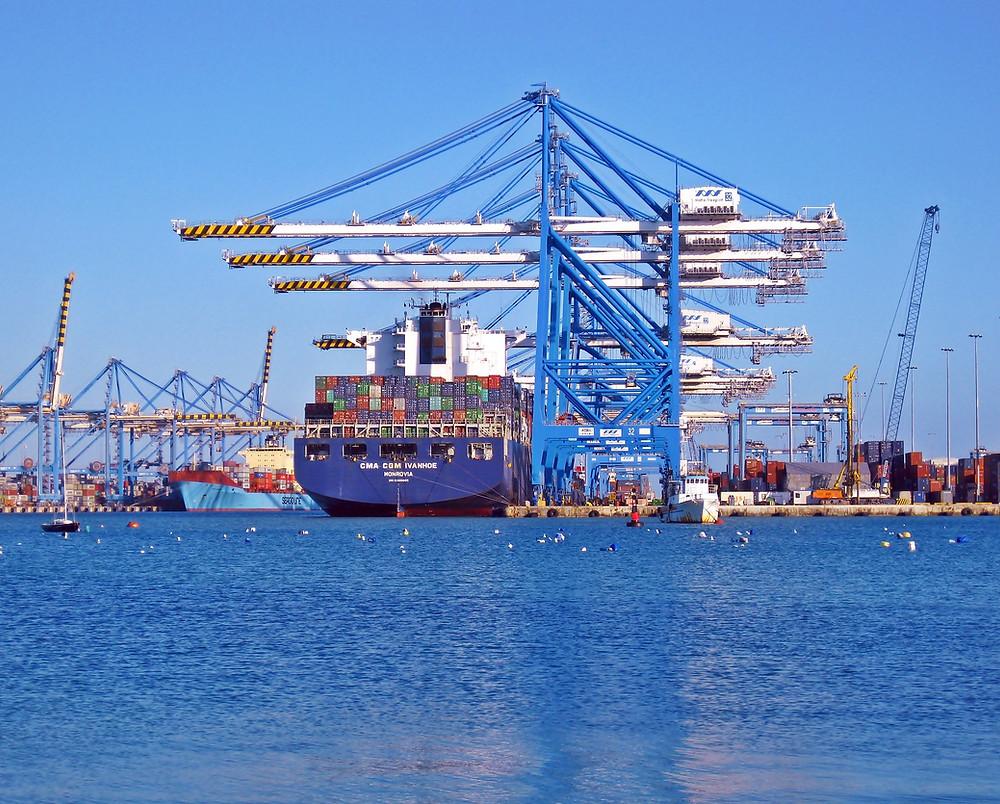 Cargo Ship on Ocean unloading load