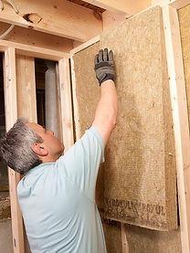 Man Adding Insulation