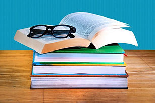stack-of-books-with-a-pair-of-eyeglasses
