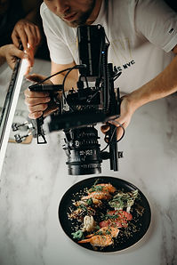 man-using-video-camera-pointing-on-food-