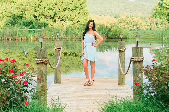 A lovely senior picture on the dock at the pond.