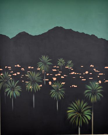 Pueblo nocturno desde las palmeras