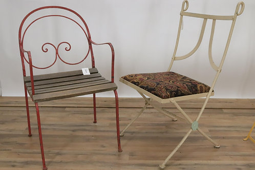 Two hand wrought iron garden chairs