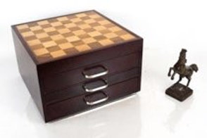 a chess/checkers and other games set in acompartmented box