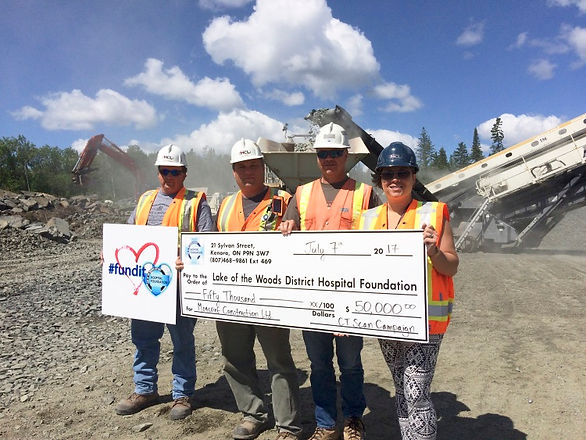 Construction workers donating a cheque