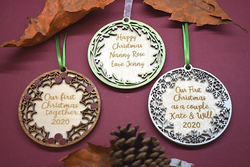 Traditional personalised Christmas decoration in holly, mistletoe and snowflake