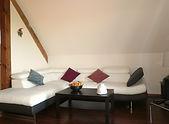 Salon/zithoek van Jonquille, een vakantiewoning voor 4 tot 5 personen.