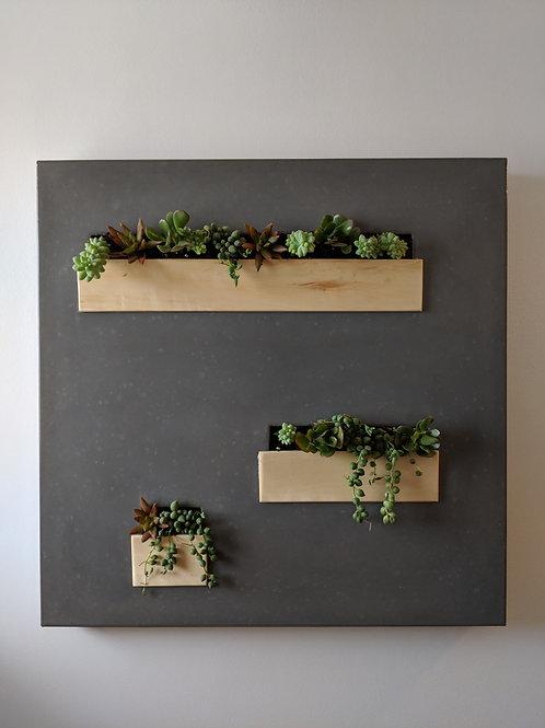 Concrete wall mounted planter
