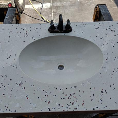 Custom conrete countertop with glass