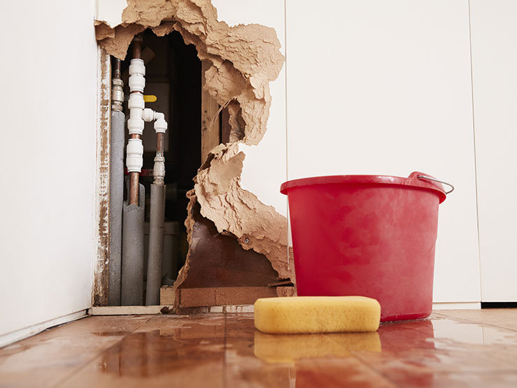 damaged-wall-exposed-burst-water-pipes-s