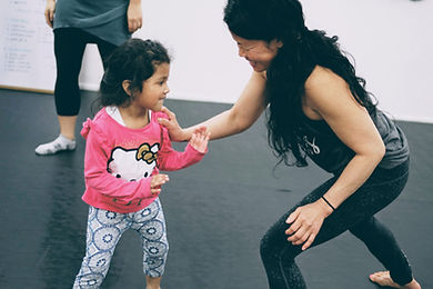 woman and girl practicing self-defense