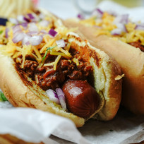 Homemade Chili dogs topped with cheddar