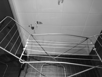 Сreative approach to renovation; drying rack fixed with cord to prolong it's life