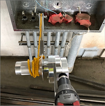 CP1000 Cordless Circuit Puller with rope cleat pulling into subpanel with cordless drill power