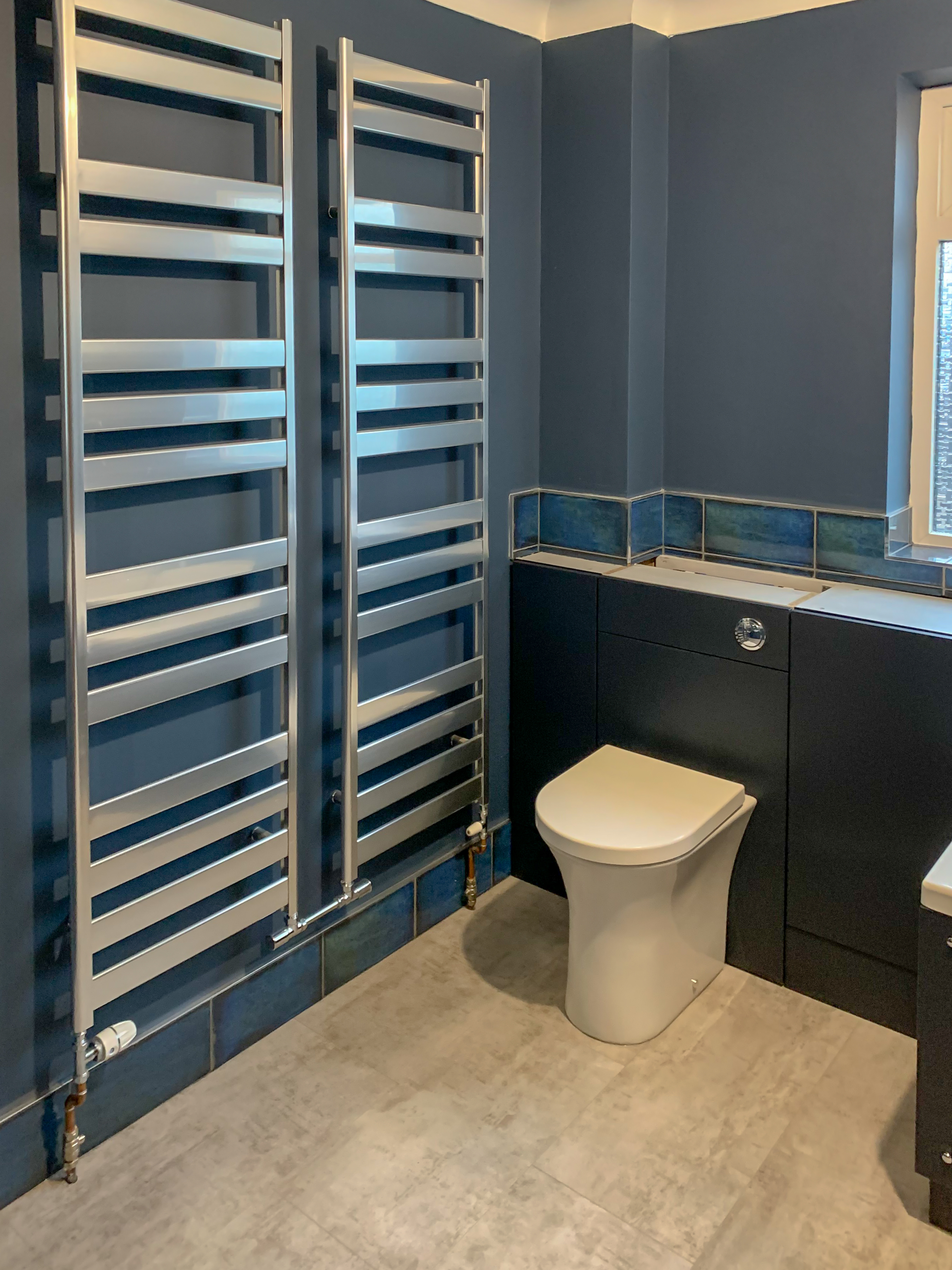 Bespoke cabinets and twin Aluminium high output towel rails