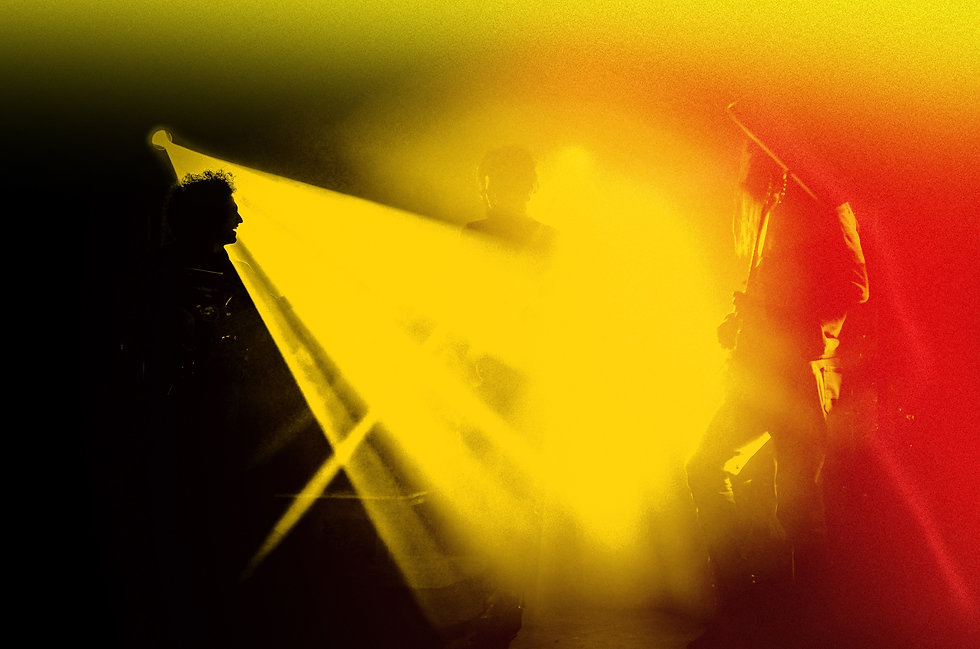 man in black shirt standing on stage_edited.jpg
