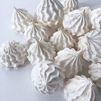 Vanilla and rosewater meringue kisses.