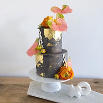 Two tier wedding cake of sumptuous coconut cake with silky coconut swiss meringue buttercream.
