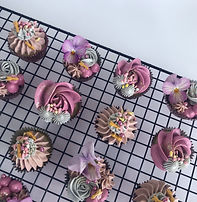 Mini vanilla or chocolate cupcakes with edible blooms.
