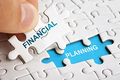 Hand holding piece of puzzle with words Financial Planning. Business concept.jpg