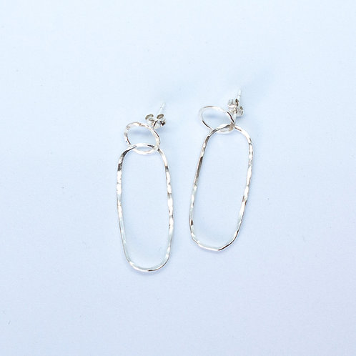 Handcrafted textured sterling silver intertwined circles stud back drop earrings made in Jerusalem,  white background