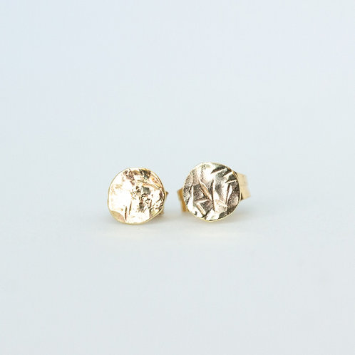 Small simple textured gold round studs handcrafted recycled gold minimal jewelry on a white background, made in Jerusalem