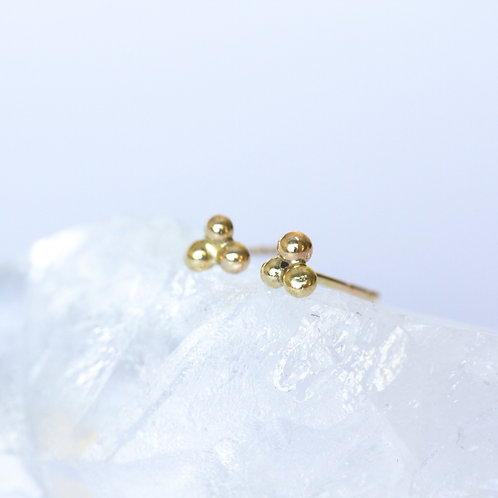 14k Gold clover design stud earrings on crystal and white background unique handcrafted jewelry from Jerusalem