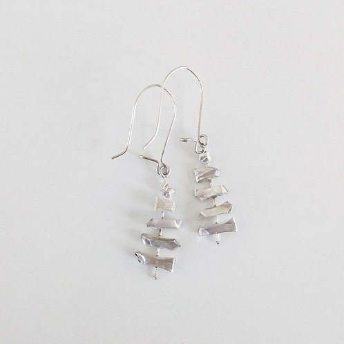 abstract recycled silver earrings on white background handcrafted in jerusalem