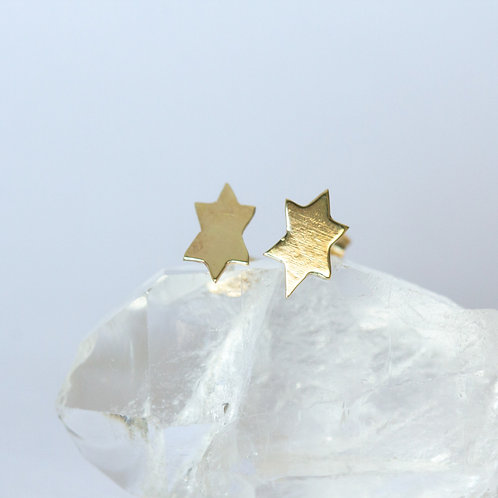 Small gold stud earrings star of david unique handcrafted jewelry from Jerusalem on a white and crystal background