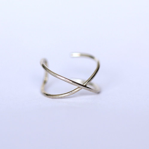 Sterling silver X ear cuff handcrafted in Jerusalem on white background