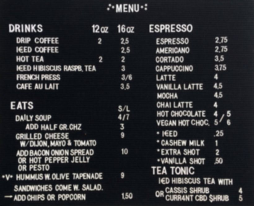 Menu for espresso, grilled cheese sandwiches, and teas