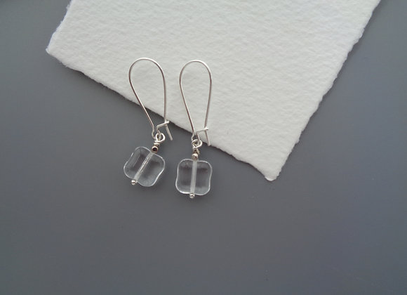 Smooth Clear Glass Silver Kidney Earrings.