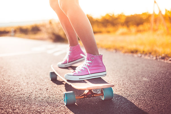 young-girl-with-pink-shoes-riding-a-long
