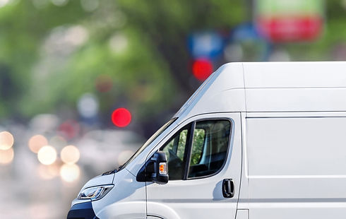 Fast delivery, van on city street blured