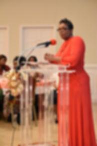 Tara T. Stallins speaking at a podium