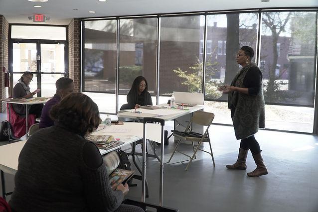 Tara T. Stallins teaching a vision board class