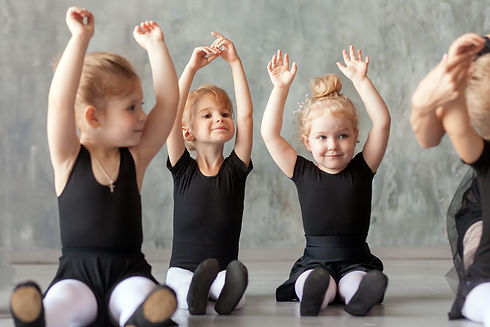 little girls ballerina in black dresses,