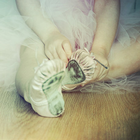 ballerina puts on pointe.jpg