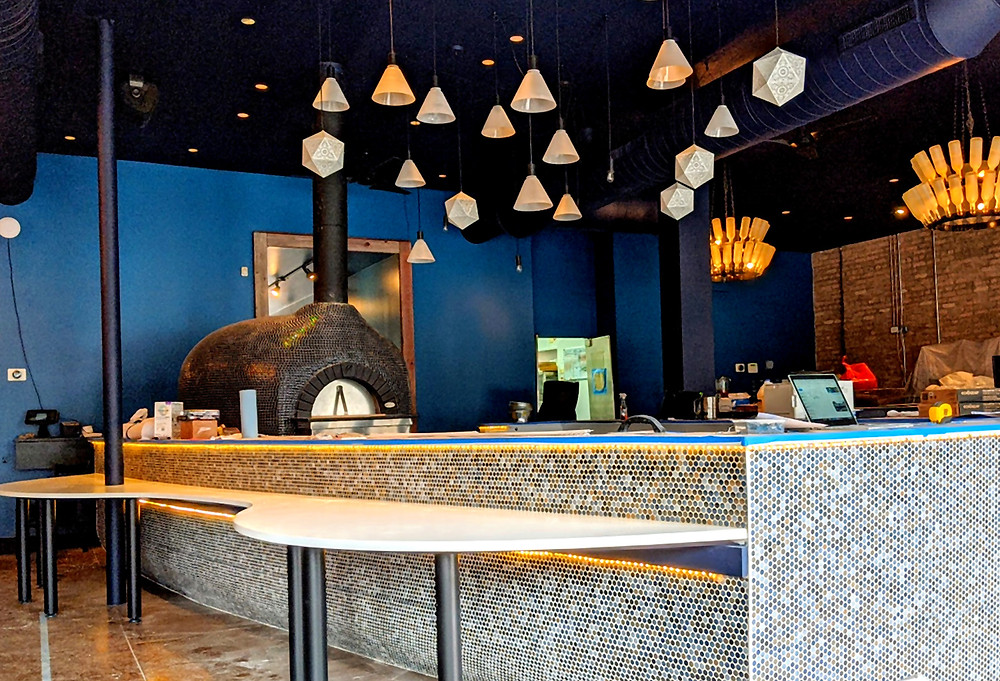 Central interior island with wood burning oven at Israeli restaurant Fiya at 5419 North Clark Street in the Andersonville neighborhood of Chicago.