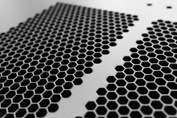 Close-up, shallow focus of a meshed style cooling panel used on a main frame computer, hou