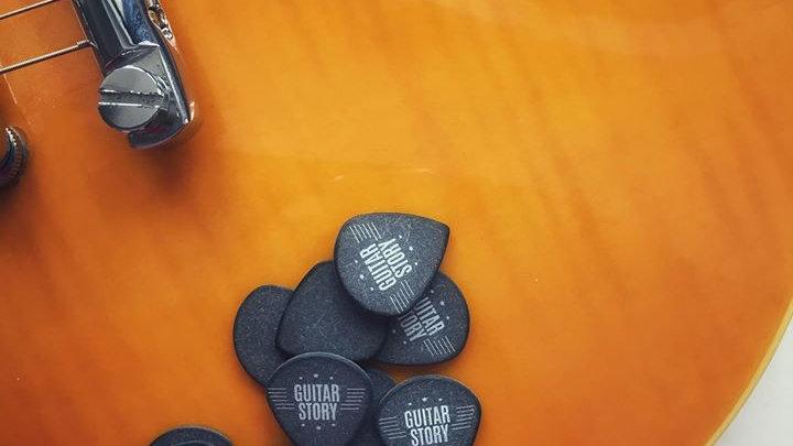 Pic de guitare (sac de 4 pics)