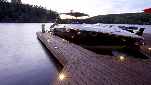 Dock lighting near a boat, done by Nightscapes