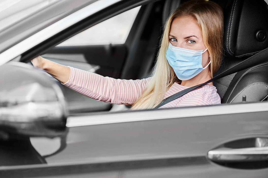 woman-in-a-protective-mask-driving-a-car