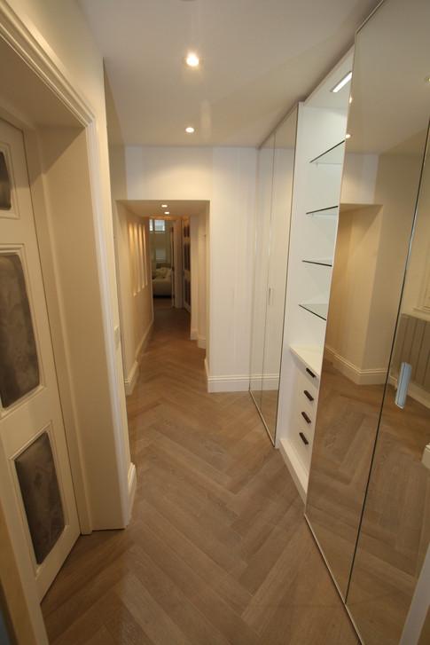 Hallway, hidden utility & cloaks