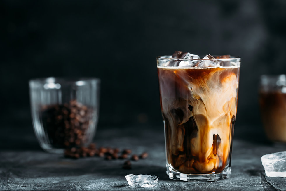 milk-being-poured-into-iced-coffee-on-a-