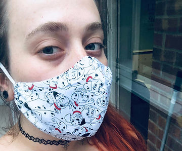 a selfie of a woman wearing a mask