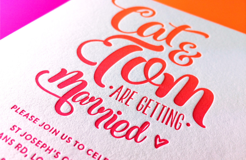 Wedding invitations letterpressed with fluorescent ink
