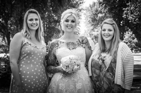 A bride and her bridesmaids are shown near Hull Guildhall.