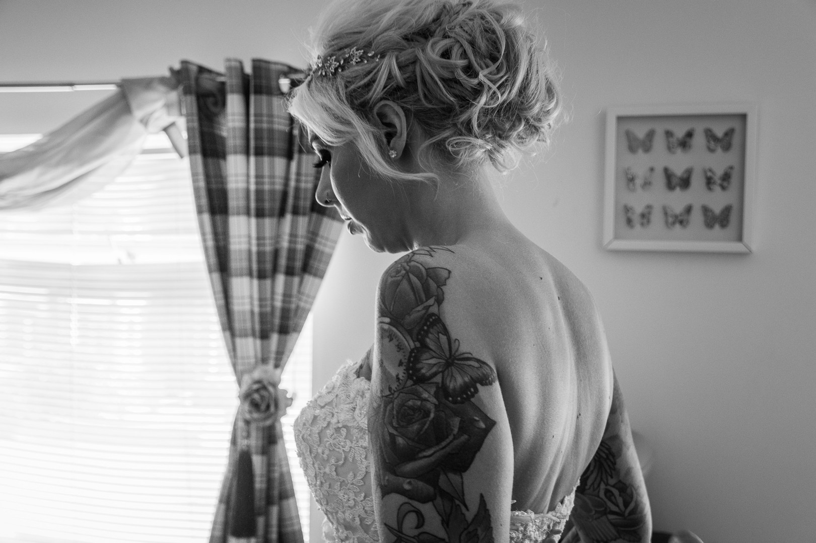 A bride takes a moment to herself in the midst of preparations before her wedding.